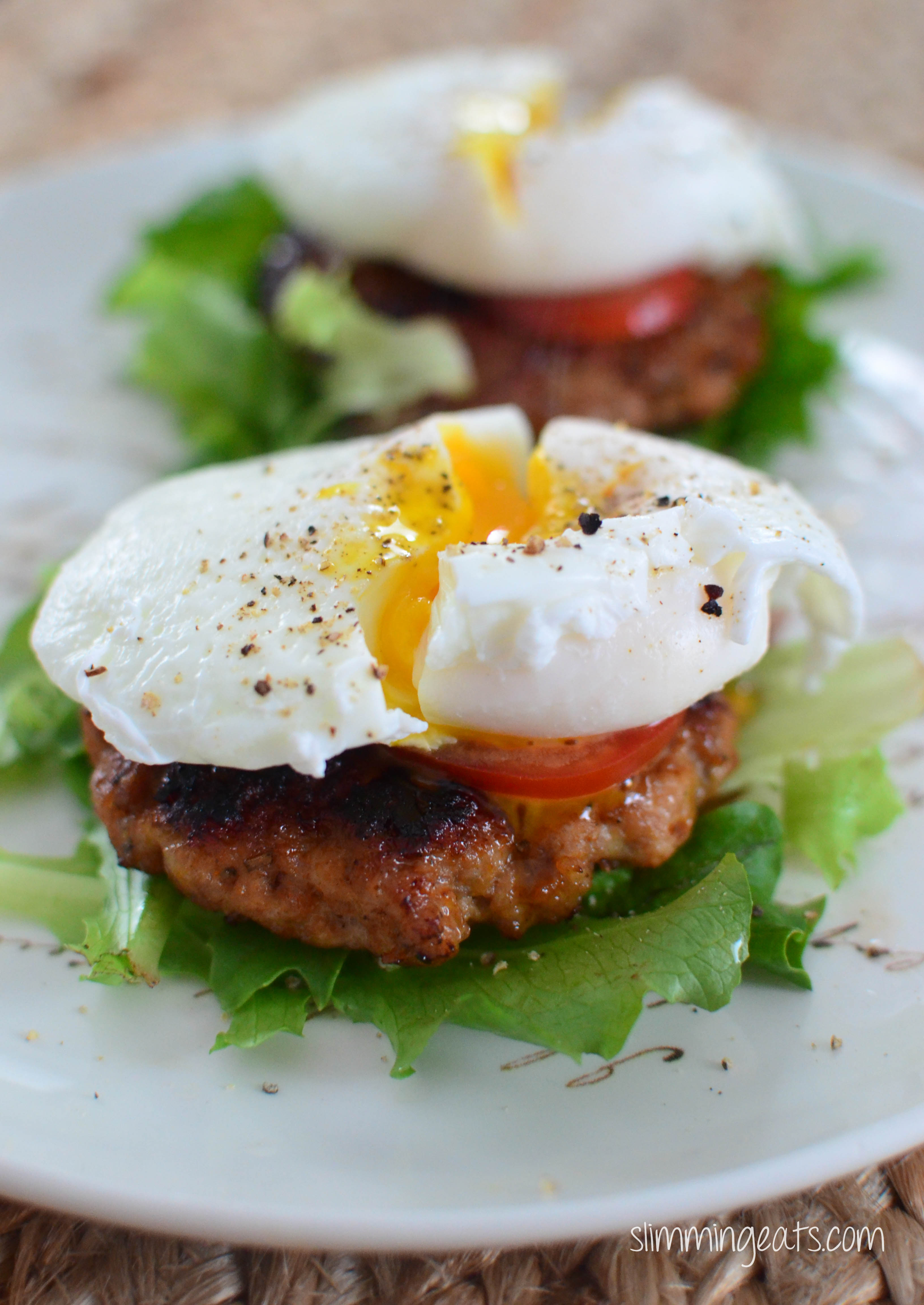 Cheats Poached Eggs over sausage Pattie with tomatoes and lettuce on white plate