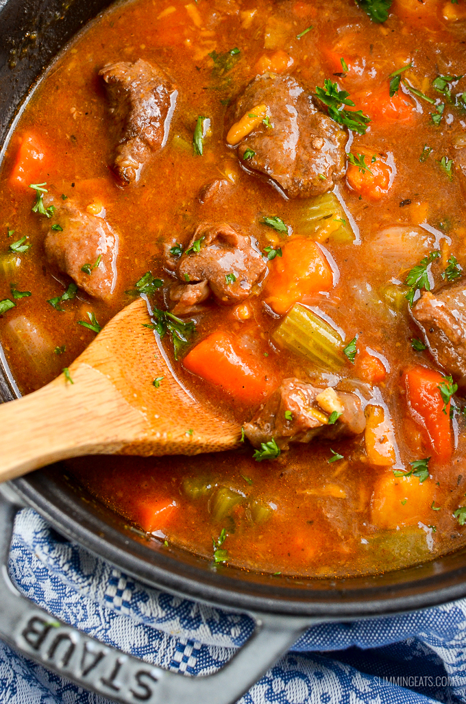close up of beef and sweet potato stew in cast iron pot