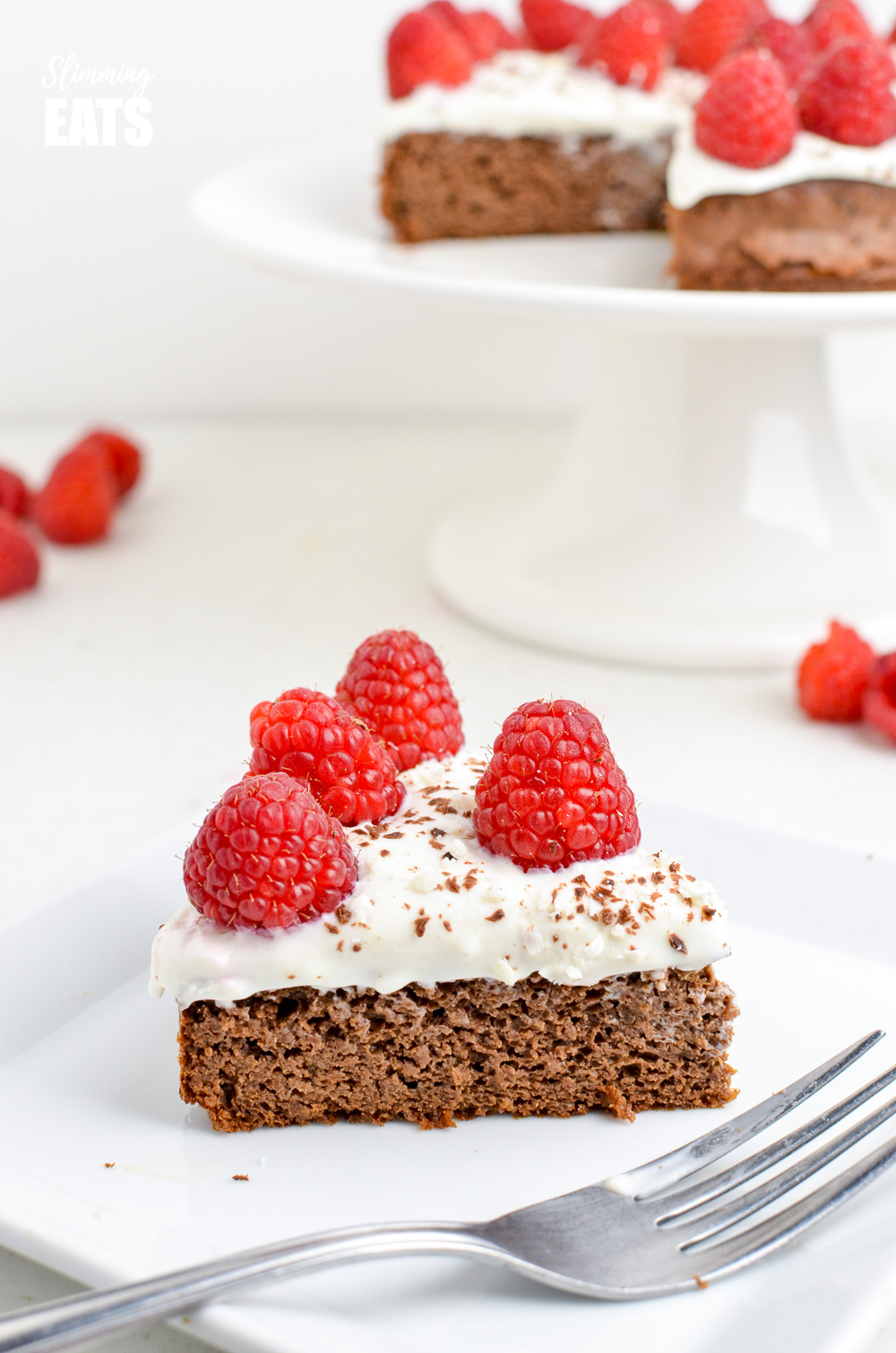 Raspberry Topped Chocolate Scan Bran Cake slice on white plate with fork