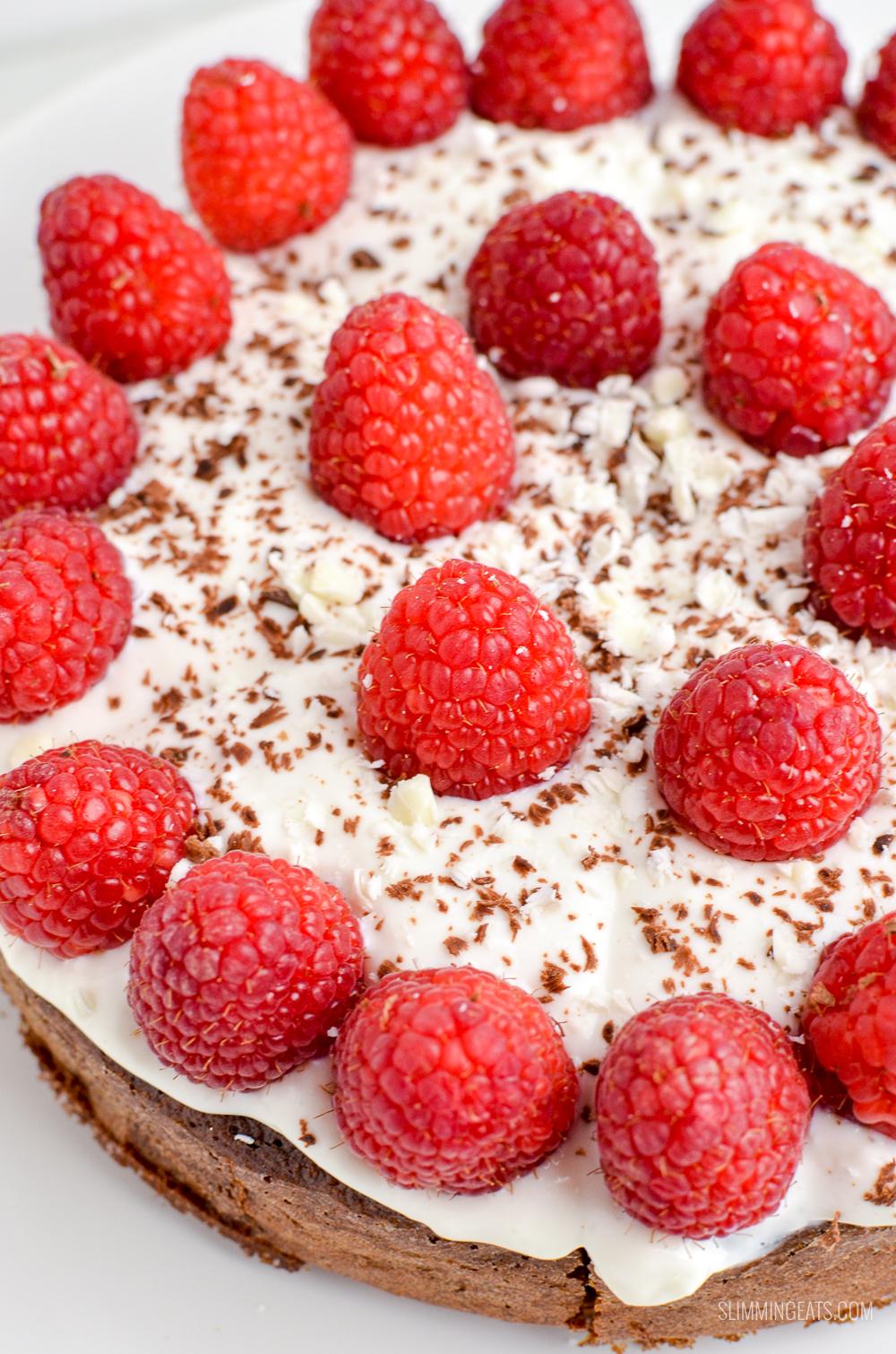 close up of raspberries on chocolate scan bran cake