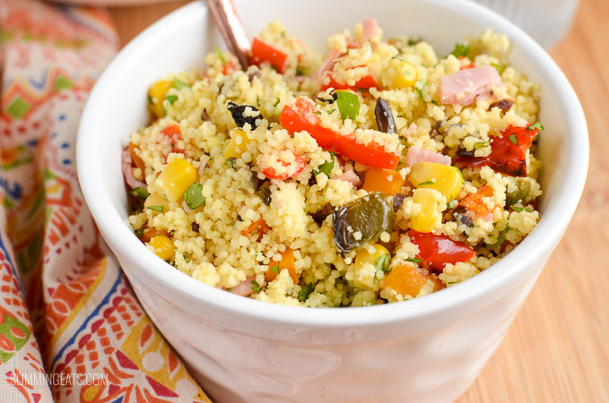 close up of white bowl with roasted vegetables and ham couscous