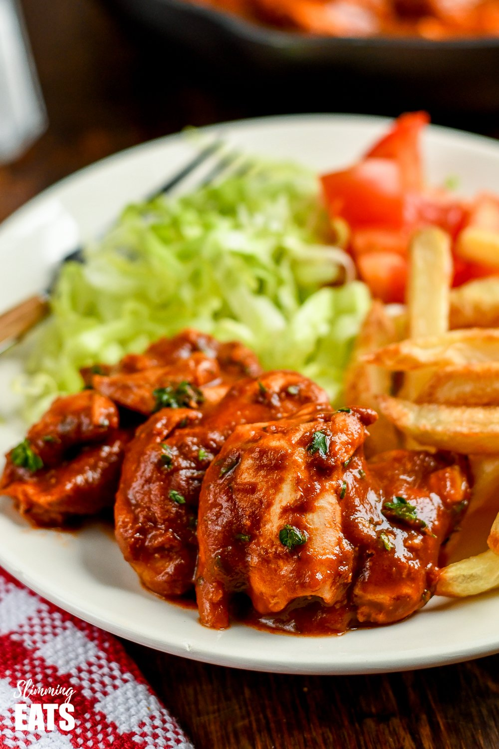 Diet Coke chicken on white plate with salad and chips