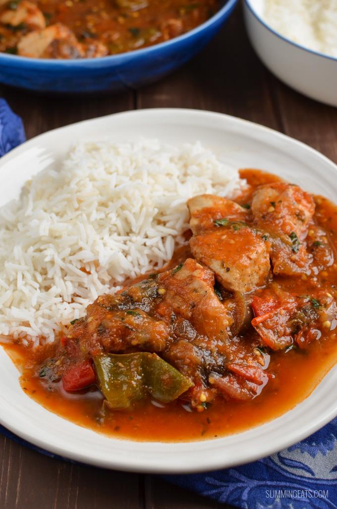 Mediterranean Chicken Chicken Casserole on white plate with rice