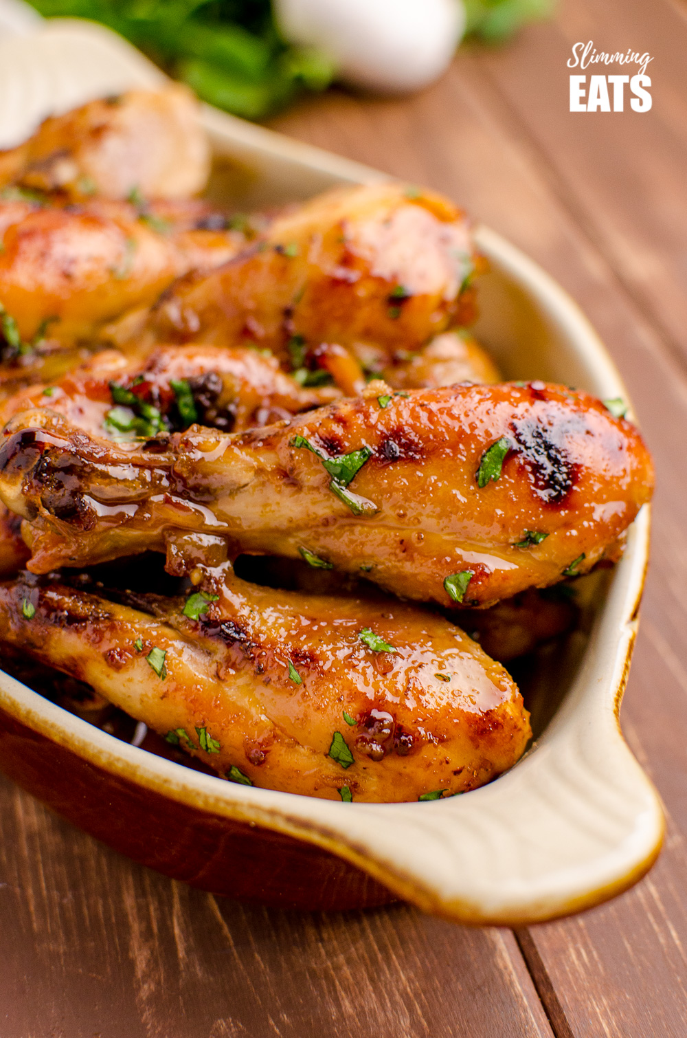 close up of Honey and Garlic Chicken Drumsticks in dish