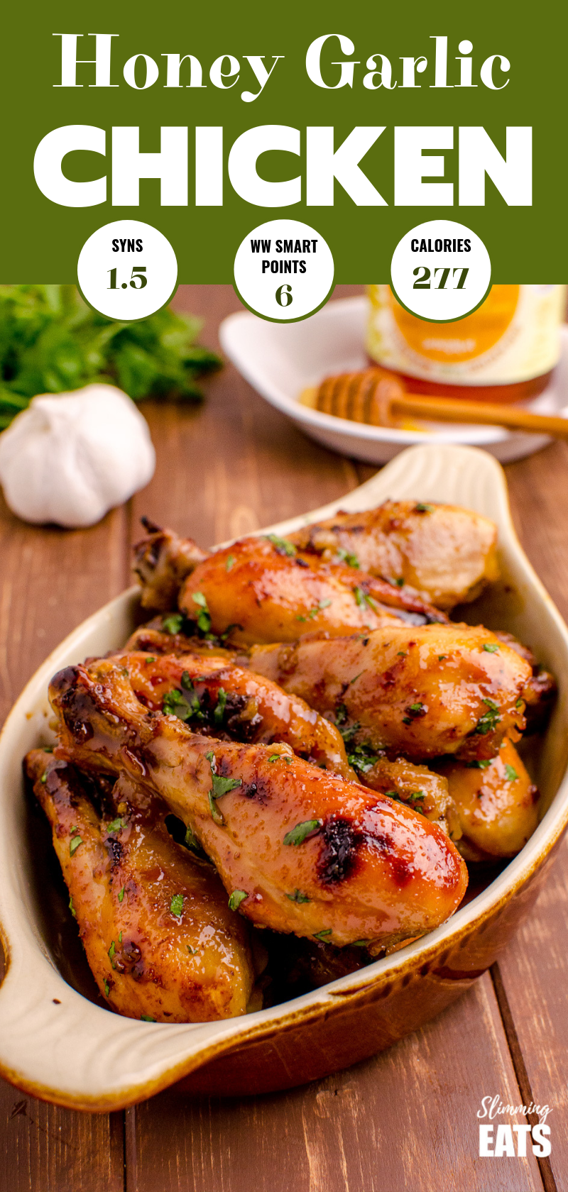 honey garlic chicken in dish on wooden board with garlic and honey in background pin