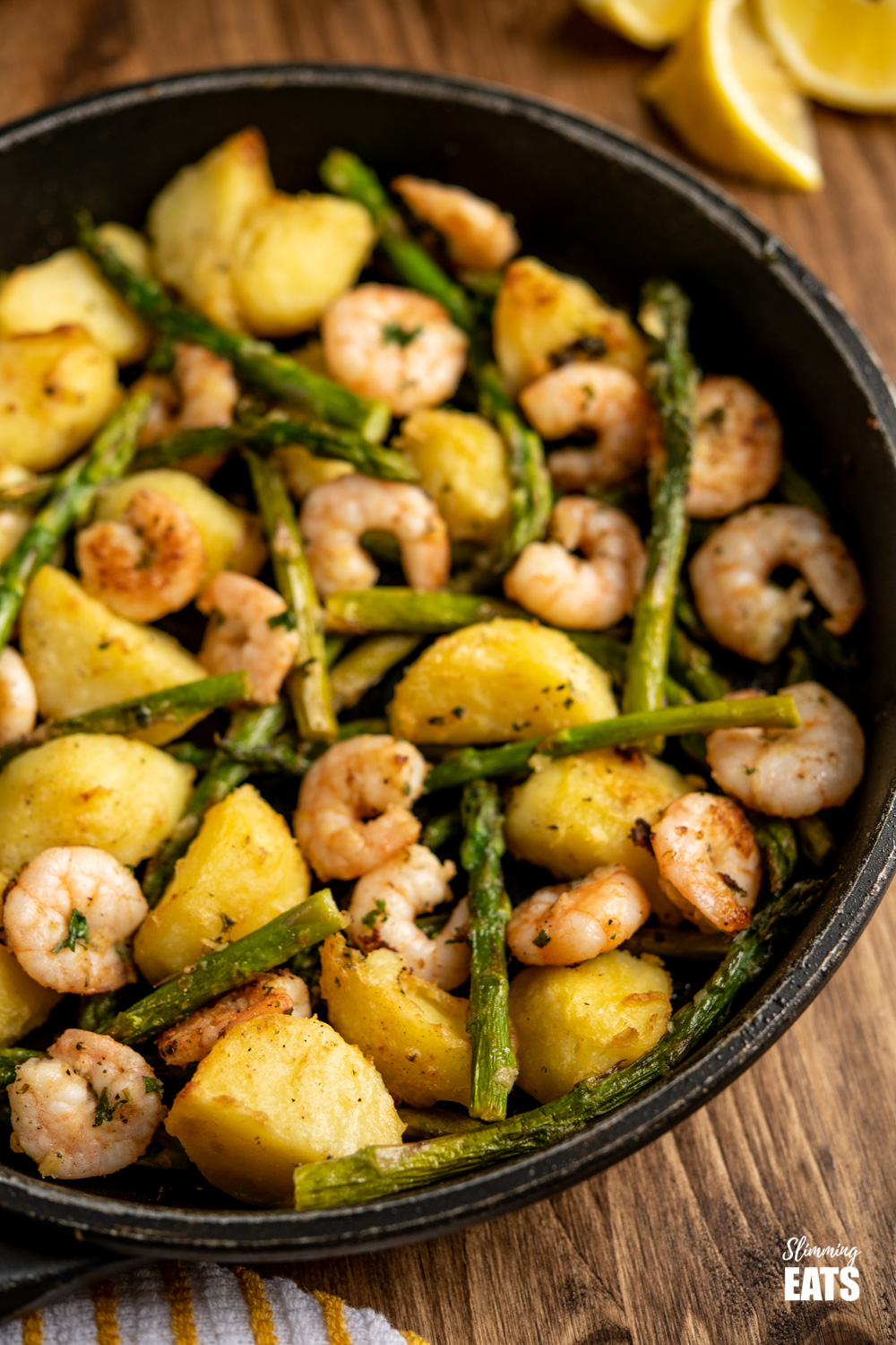 warm asparagus and prawn salad in frying pan