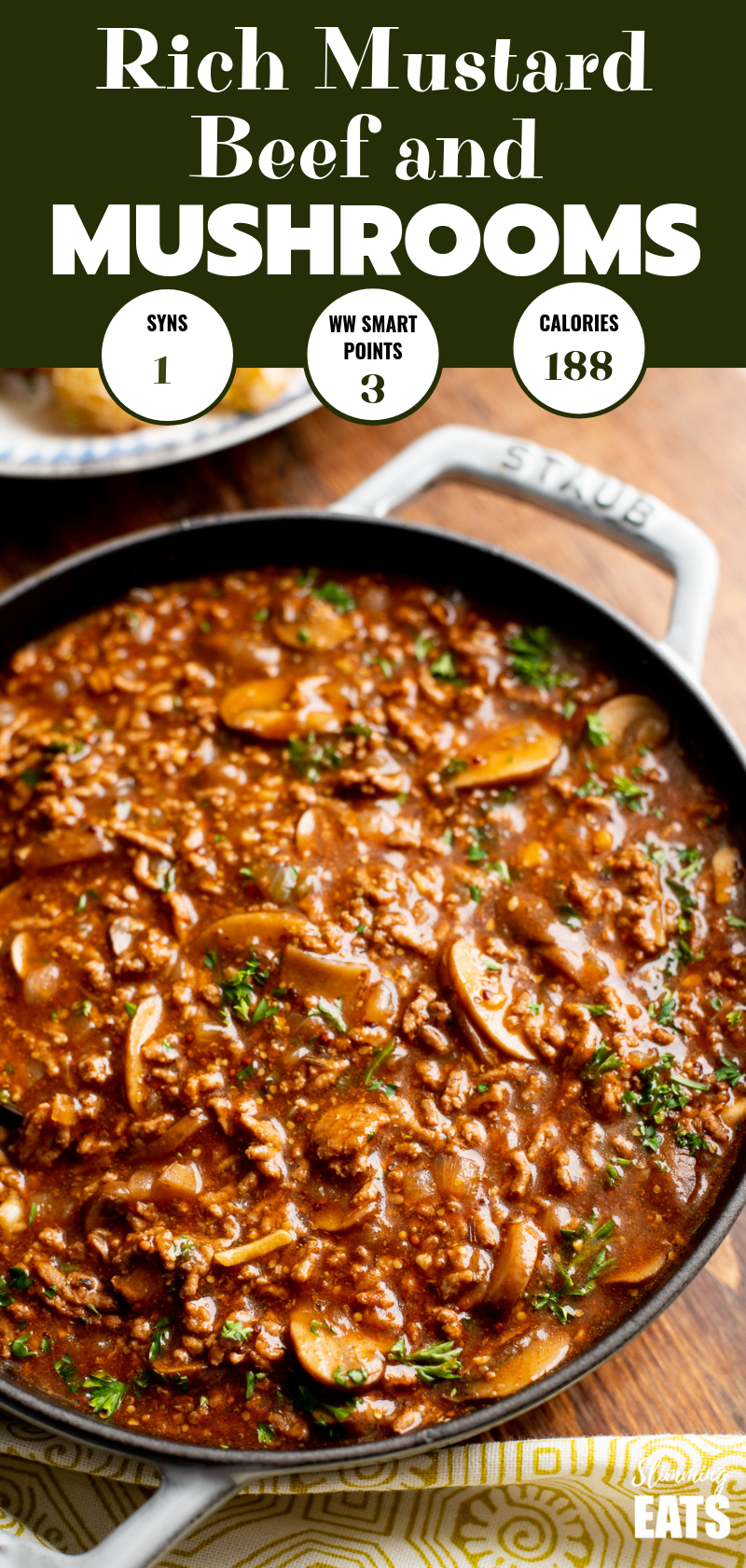 mustard beef with mushrooms in a grey staub cast iron skillet pin