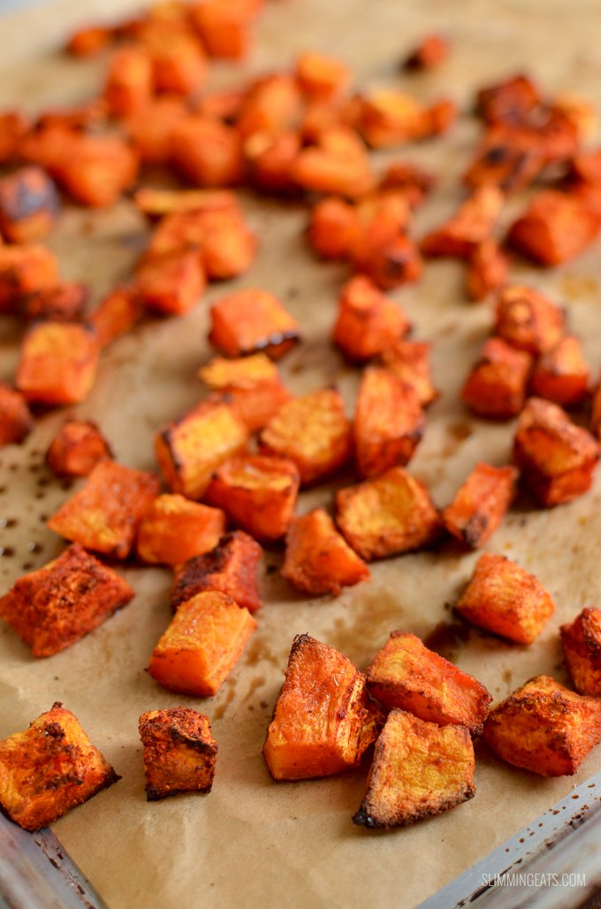roasted butternut squash on a parchment paper lined tray