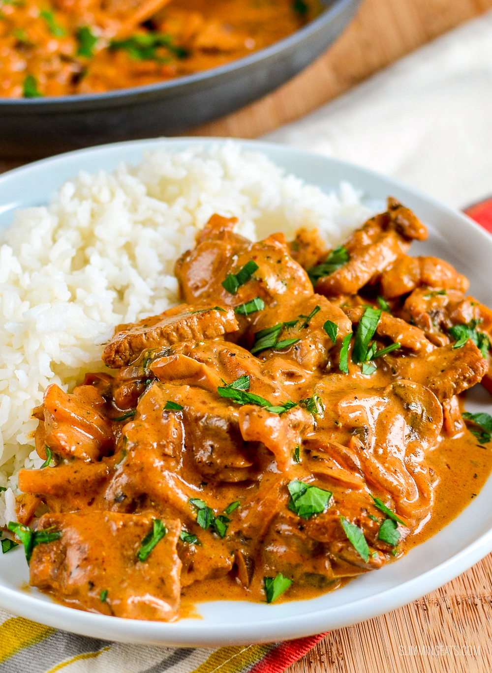 syn free beef stroganoff on a white plate with rice