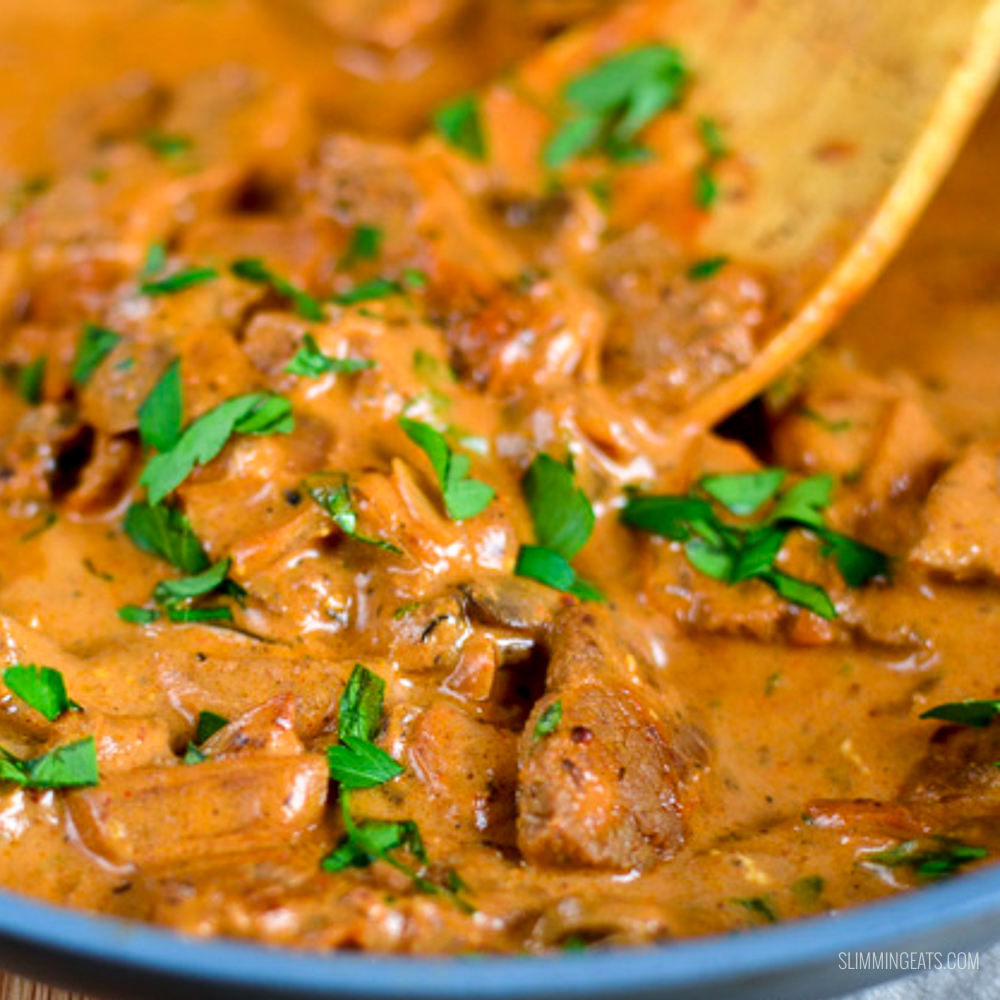syn free beef stroganoff in a frying pan with wooden spoon