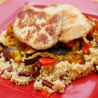 Pork Loins served on Spicy Roasted Vegetables and Couscous