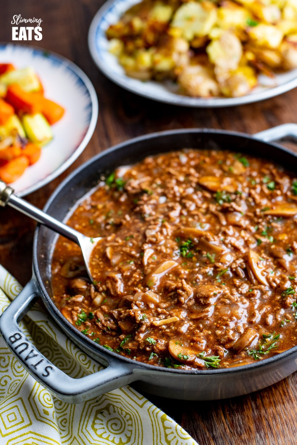 Rich Mustard Beef with Mushrooms in grey cast iron staub skillet