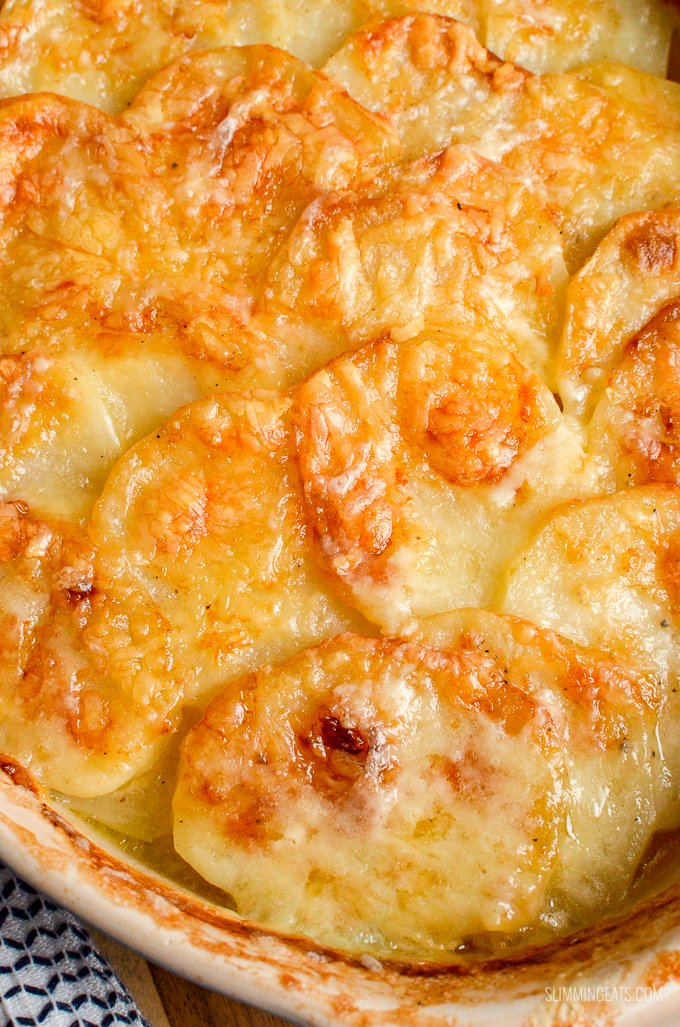 Everyone one loves a cheesy garlicky Potato Gratin and this one will not disappoint. It ticks every box and is truly scrumptious. gluten free, vegetarian, Slimming World and Weight Watchers friendly   www.slimmingeats.com