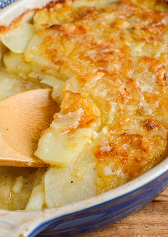 close of wooden spoon with potato gratin