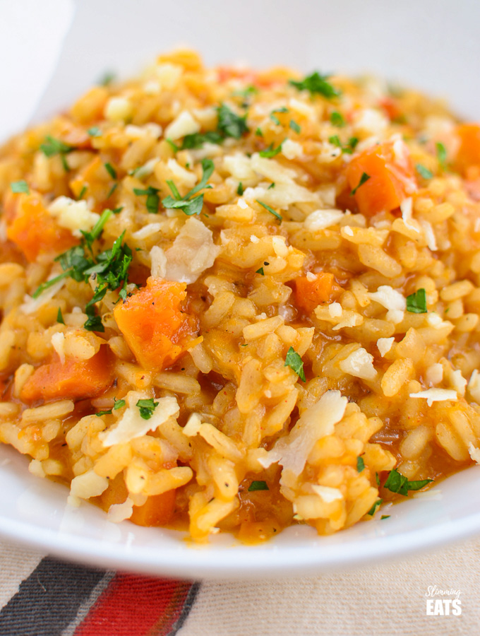 close up of roasted butternut squash risotto in white bowl