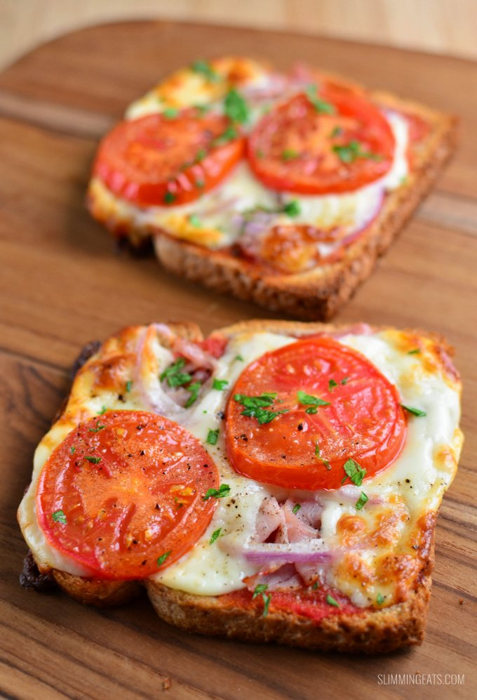 yummy pizza toasts on a wooden board