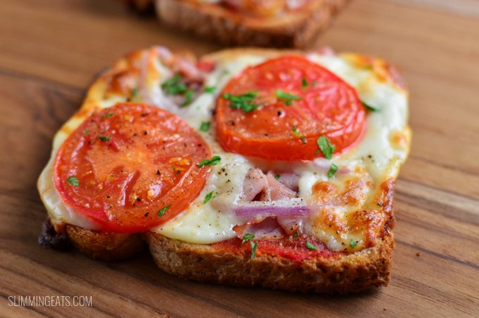 close up of pizza toast on a wooden board