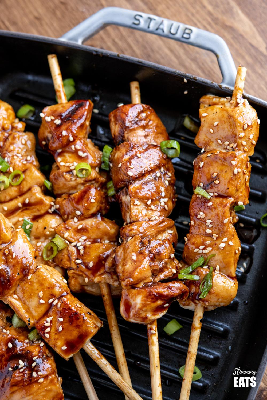 close up of Yakitori Chicken Skewers on grey staub grill pan