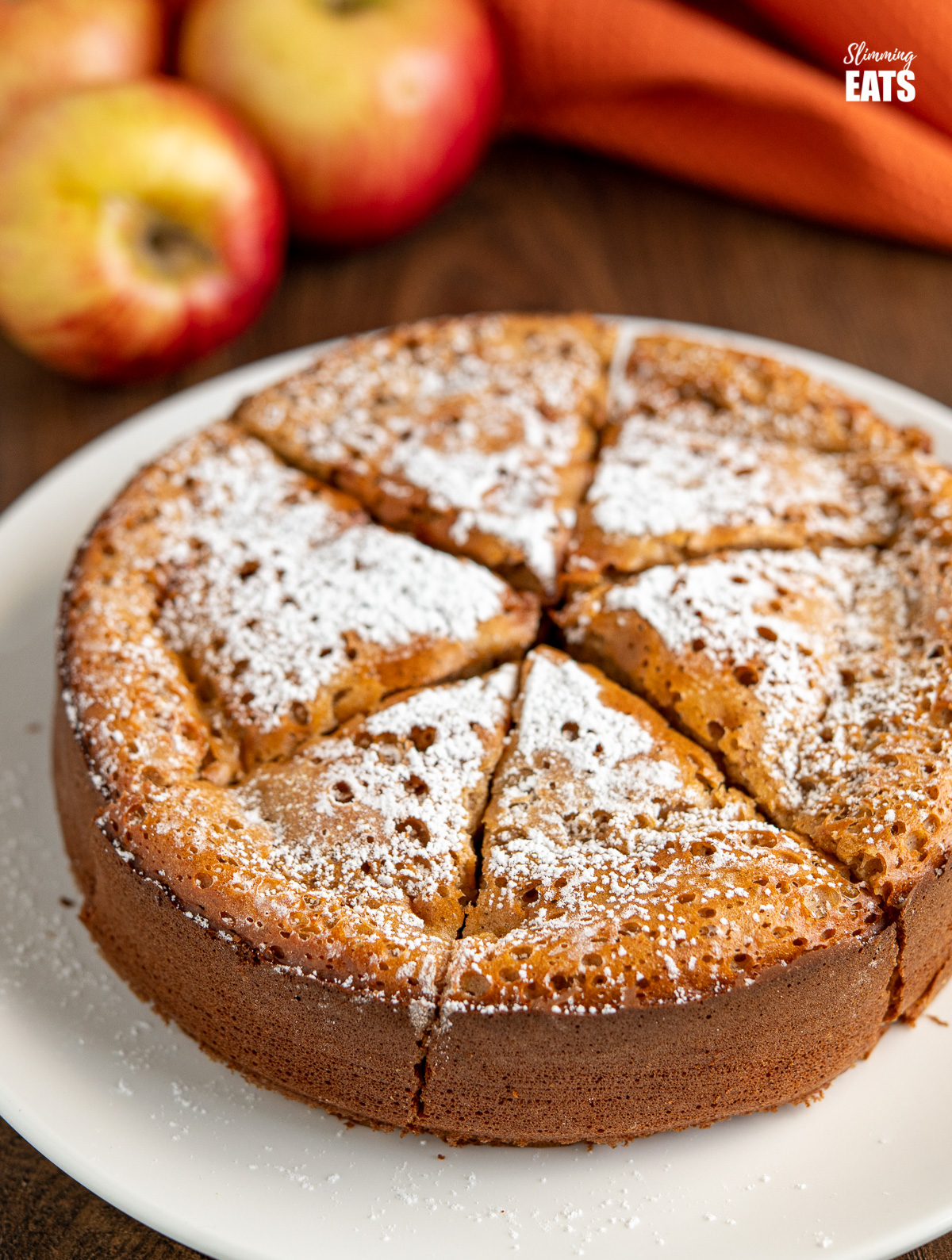 close up of sliced Apple and Sultana Cake on white plate