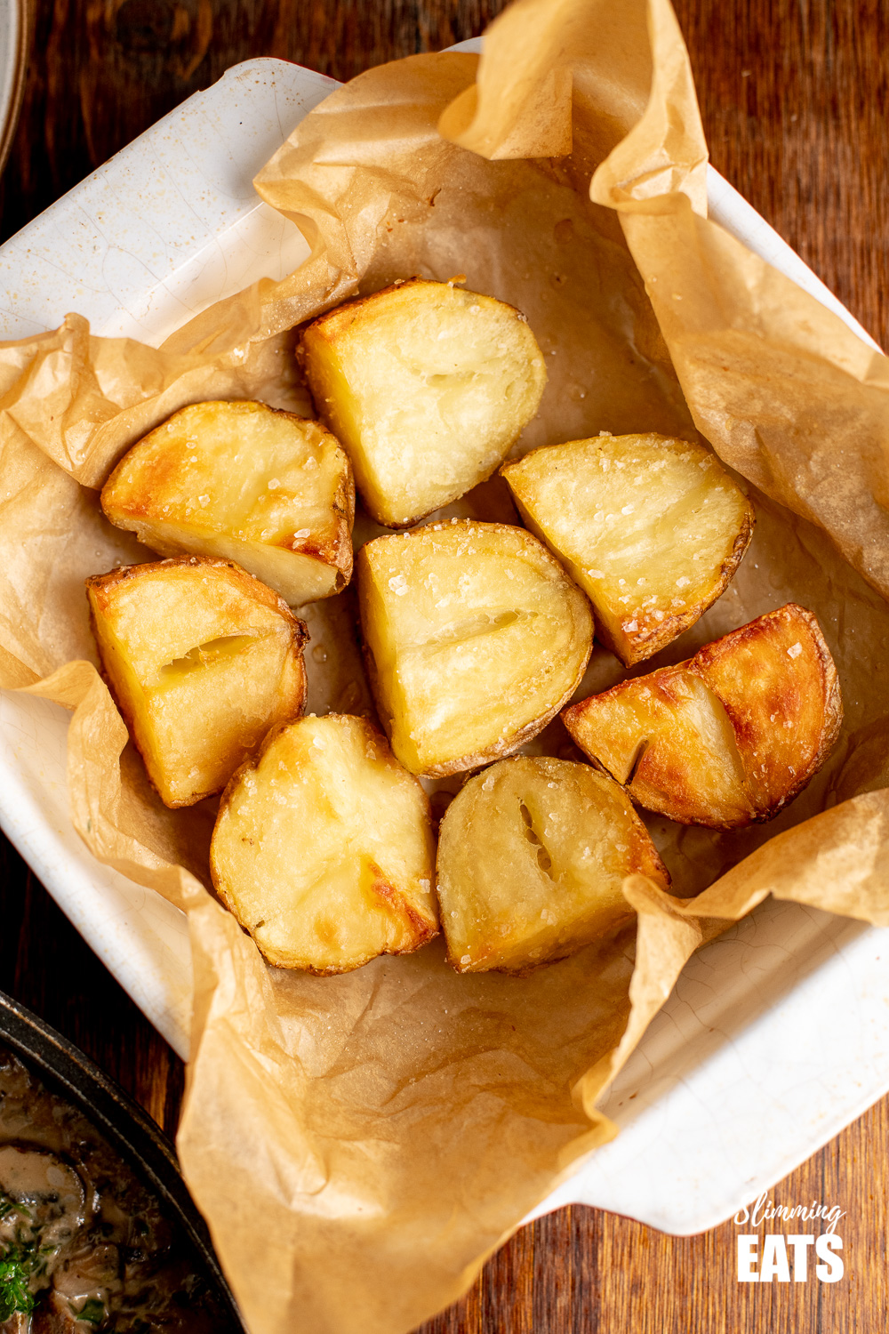 Roasted Jacket Potatoes in parchment lined baking dish