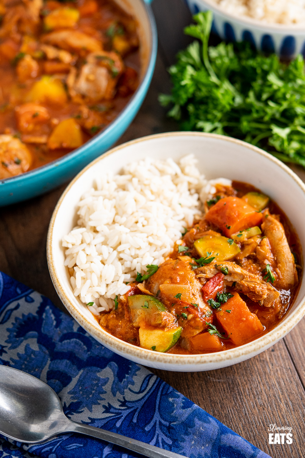 smoked paprika chicken casserole in bowl with rice on wooden board