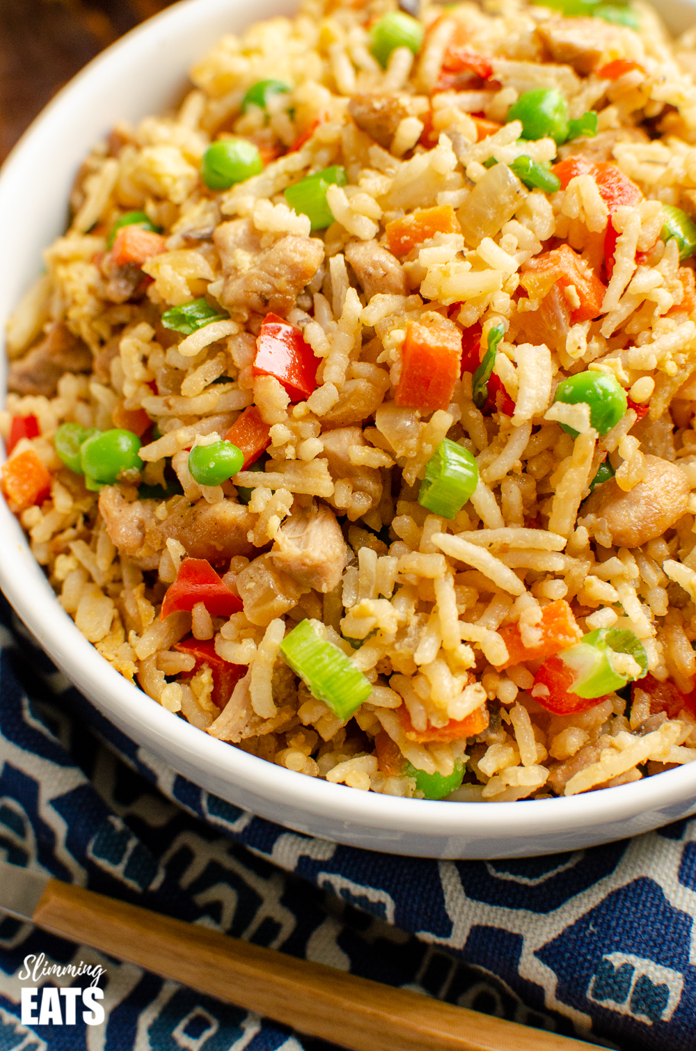 close up of chicken fried rice in white bowl