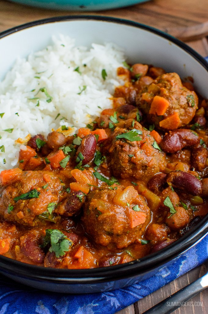 close up of lamb meatball with bean curry and rice in bowl