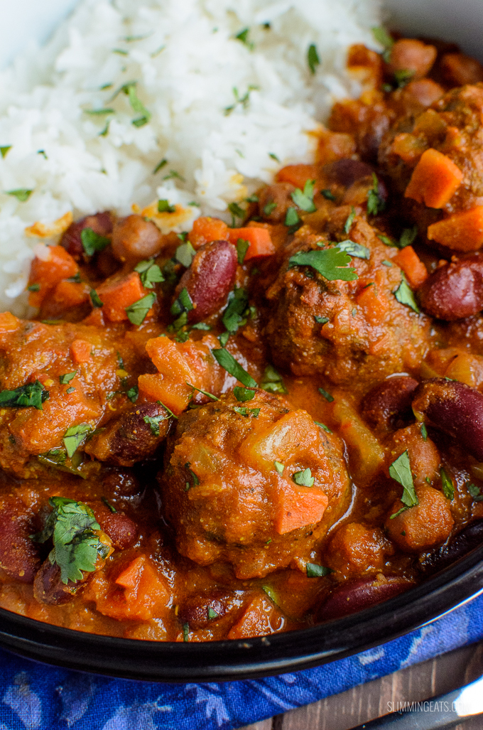 extreme close up of lamb meatball and bean curry