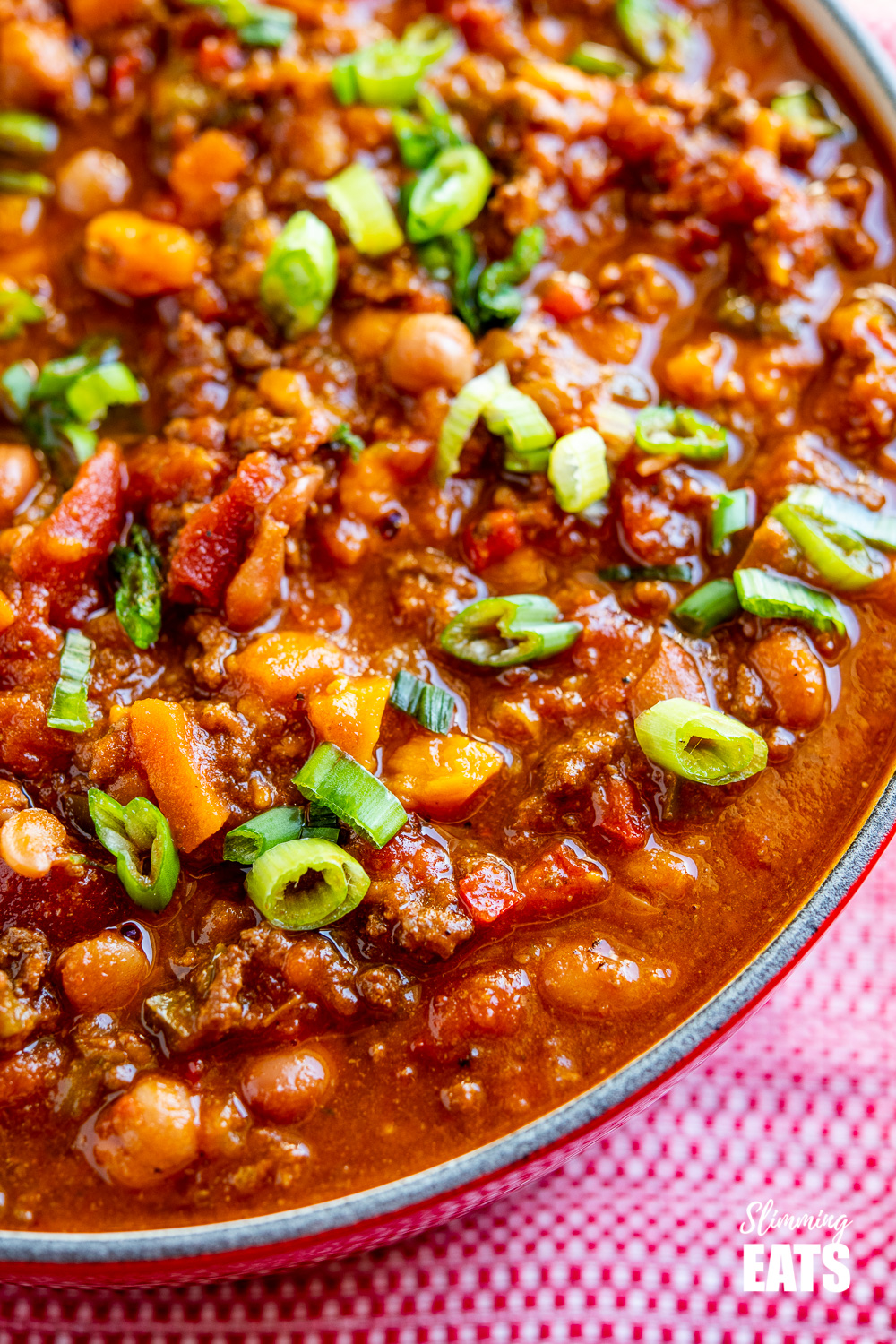 close up of beef and six bean chilli in le creuset dutch oven