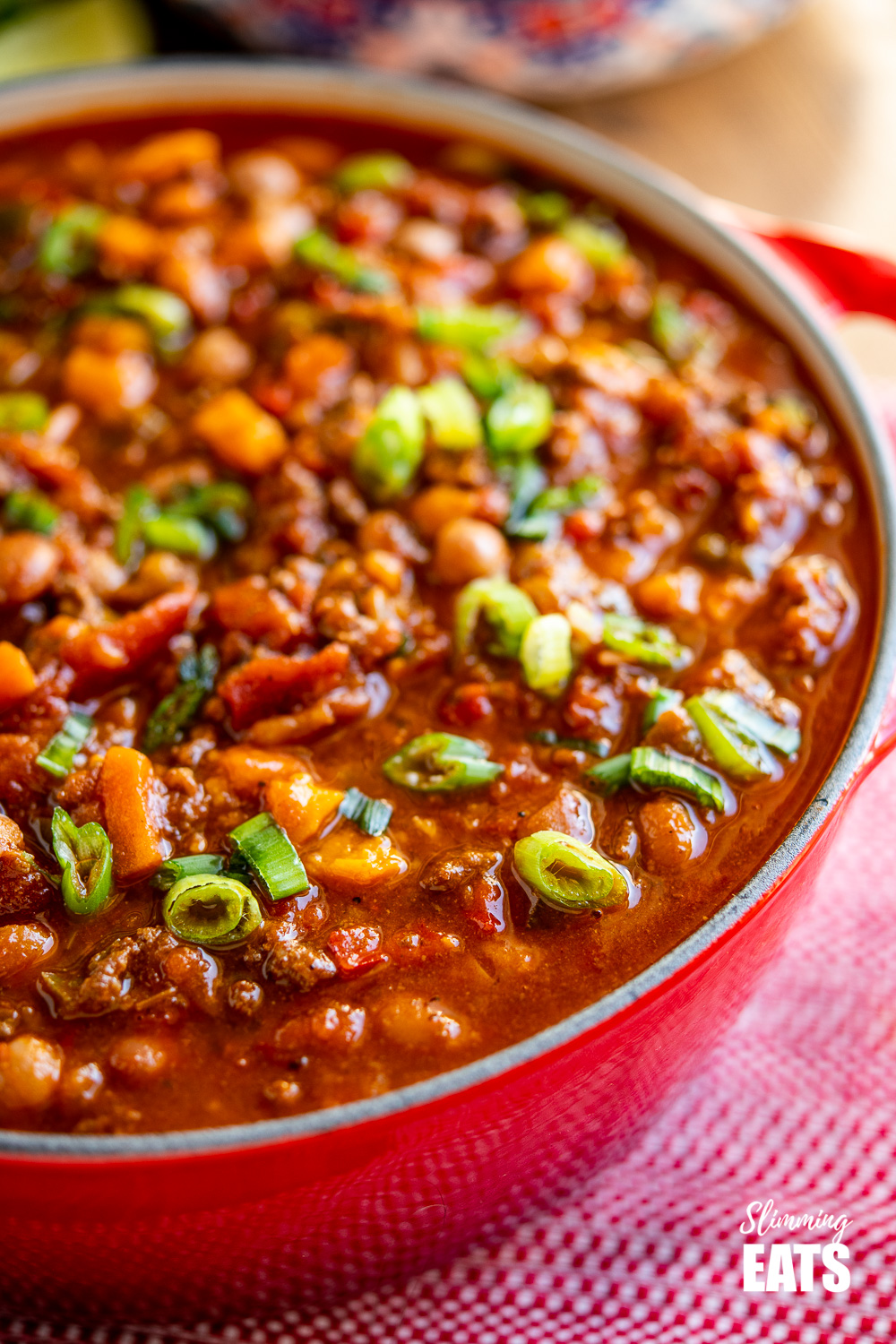 close up of beef and six bean chilli in crimson red le creuset dutch oven