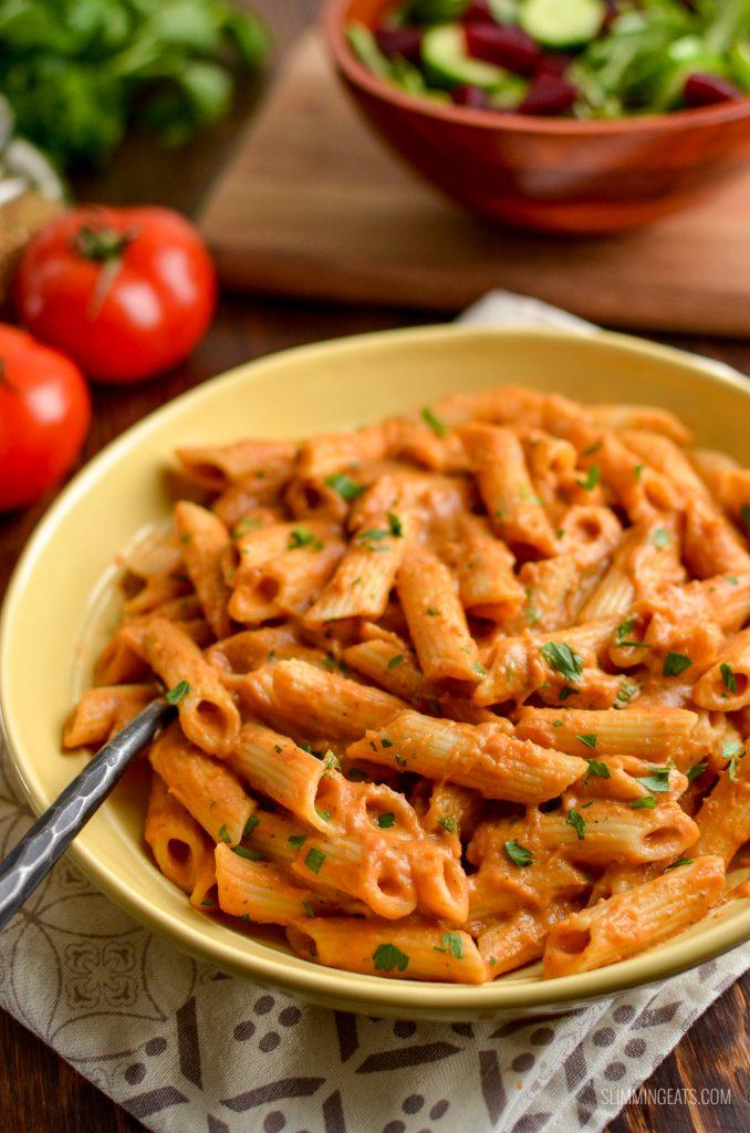 creamy tomato pasta sauce over pasta in a bowl