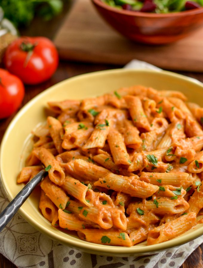 creamy tomato pasta sauce over pasta in a bowl