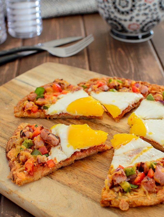 sliced breakfast hash brown pizza with coffee and knife and fork picture 2