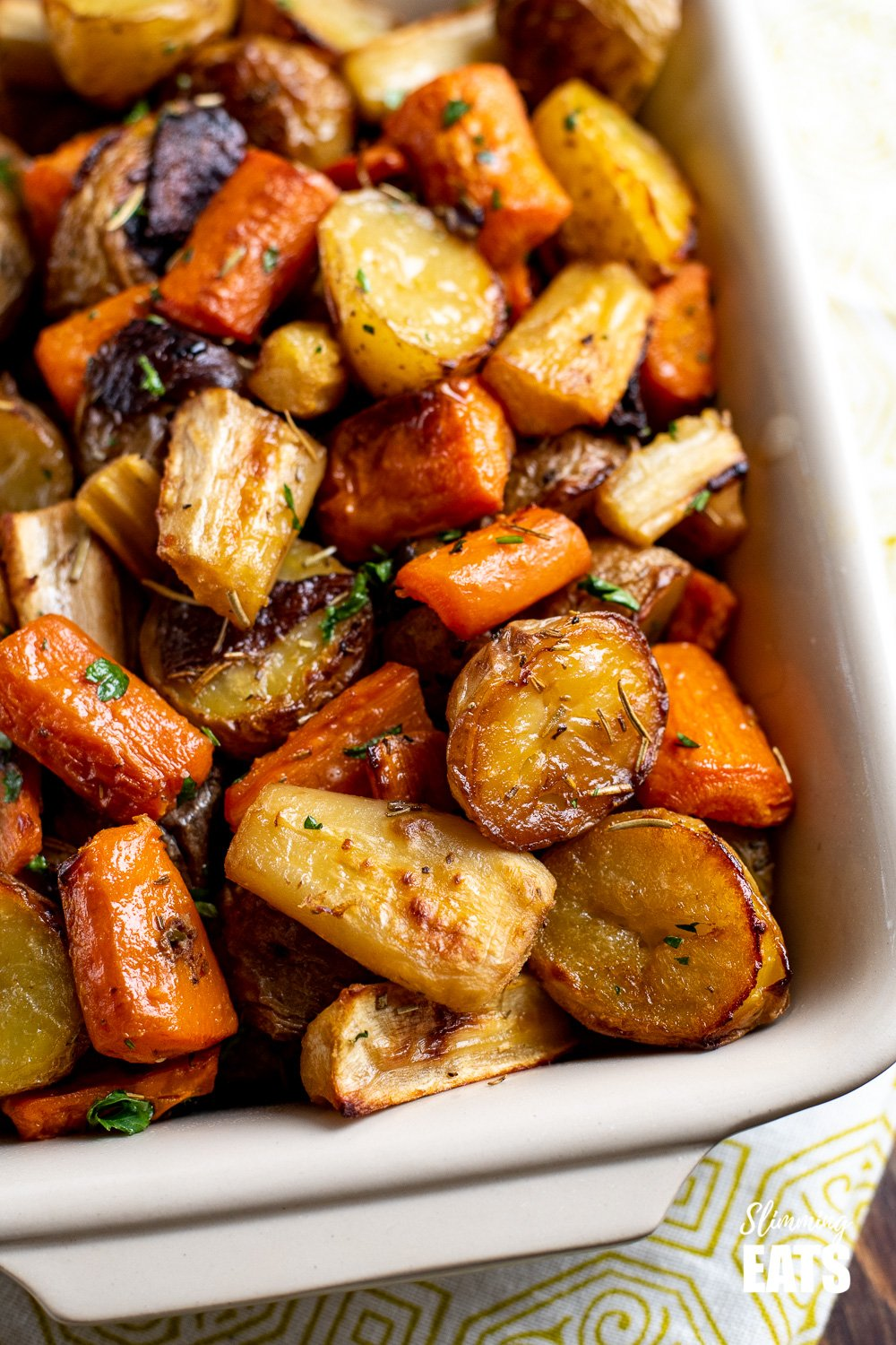 close up of Rosemary Roasted Potatoes, Parsnips, Carrots and Onion in dish