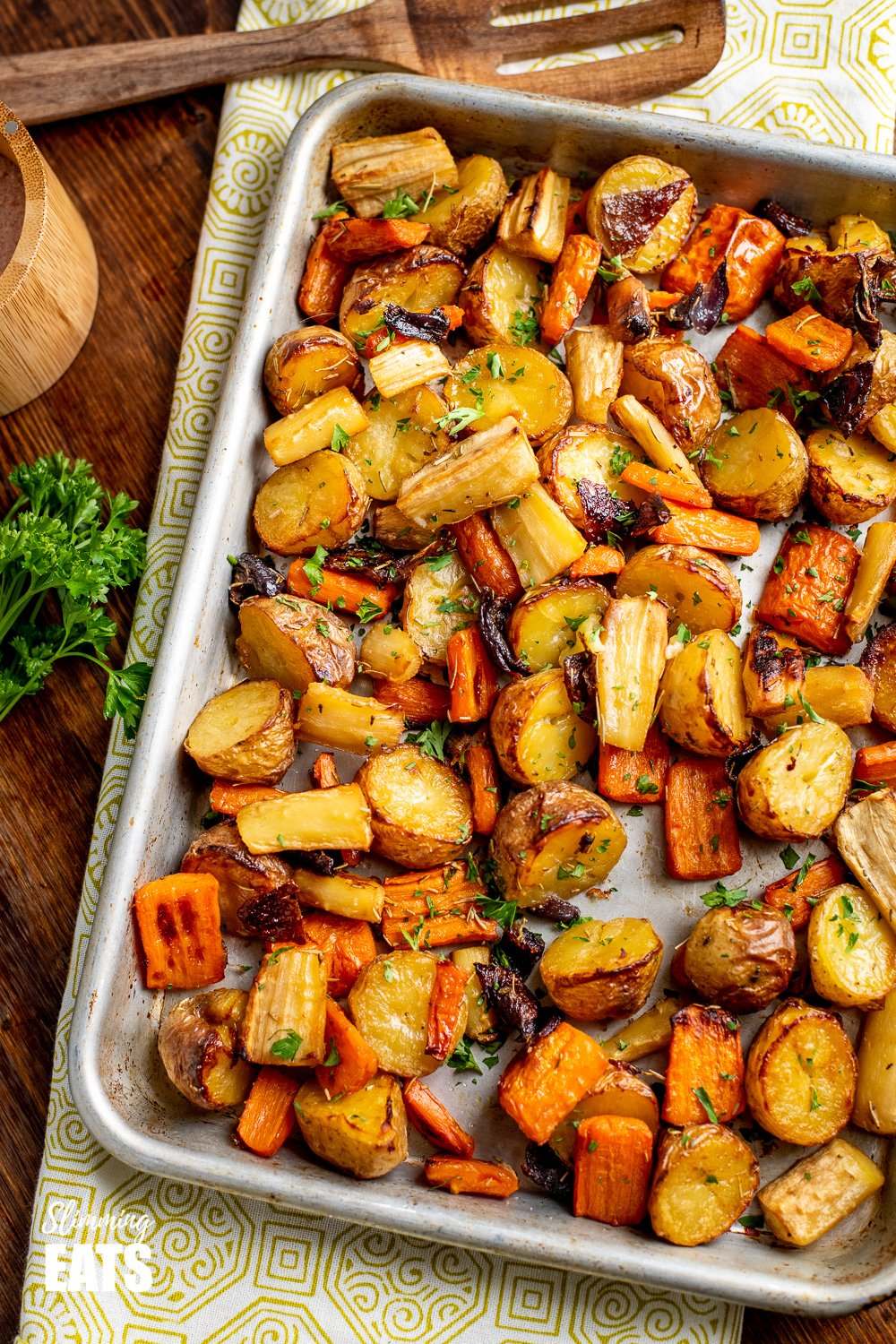 Rosemary Roasted Potatoes, Parsnips, Carrots and Onion on a baking tray