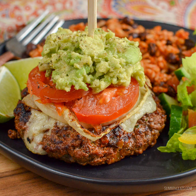 The Ultimate Slimming World Mexican Burgers - tender juicy burger stacks, topped with melted cheese, caramelized onions, ripe tomatoes and mashed avocado. Gluten-Free, Slimming World and Weight Watchers friendly   www.slimmingeats.com