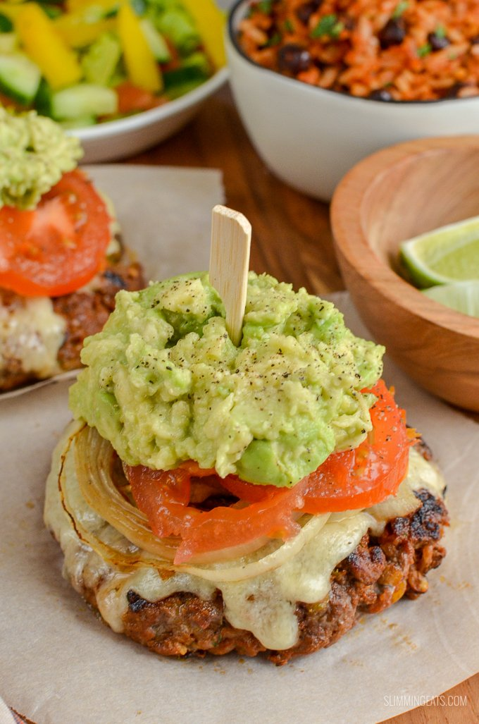 The Ultimate Slimming World Mexican Burgers - tender juicy burger stacks, topped with melted cheese, caramelized onions, ripe tomatoes and mashed avocado. Gluten-Free, Slimming World and Weight Watchers friendly | www.slimmingeats.com