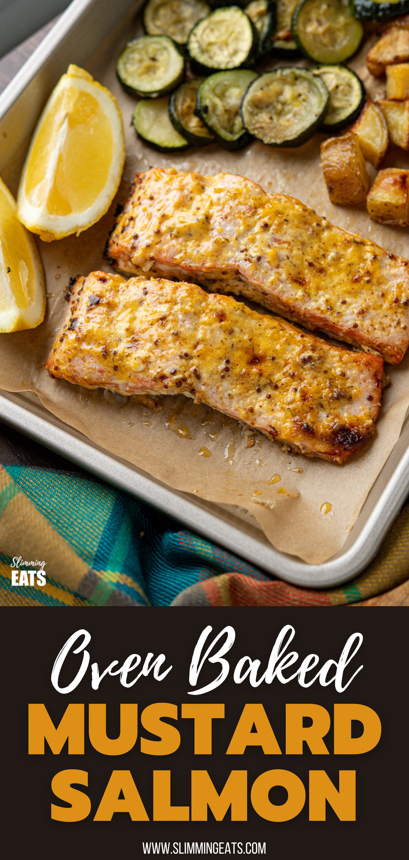 Oven Baked Mustard Salmon Fillets on parchment lined tray with potatoes, zucchini and lemon wedge