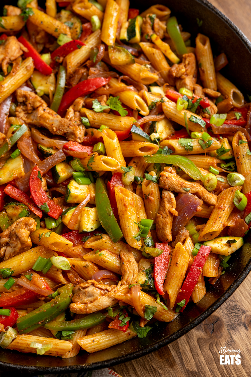 close up of Fajita Chicken Pasta in a lodge cast iron skillet
