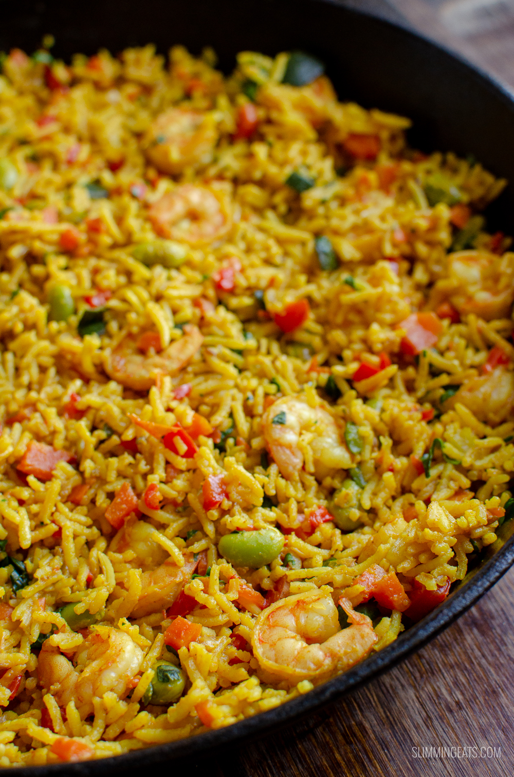 prawn and vegetable pilaf in cast iron skillet