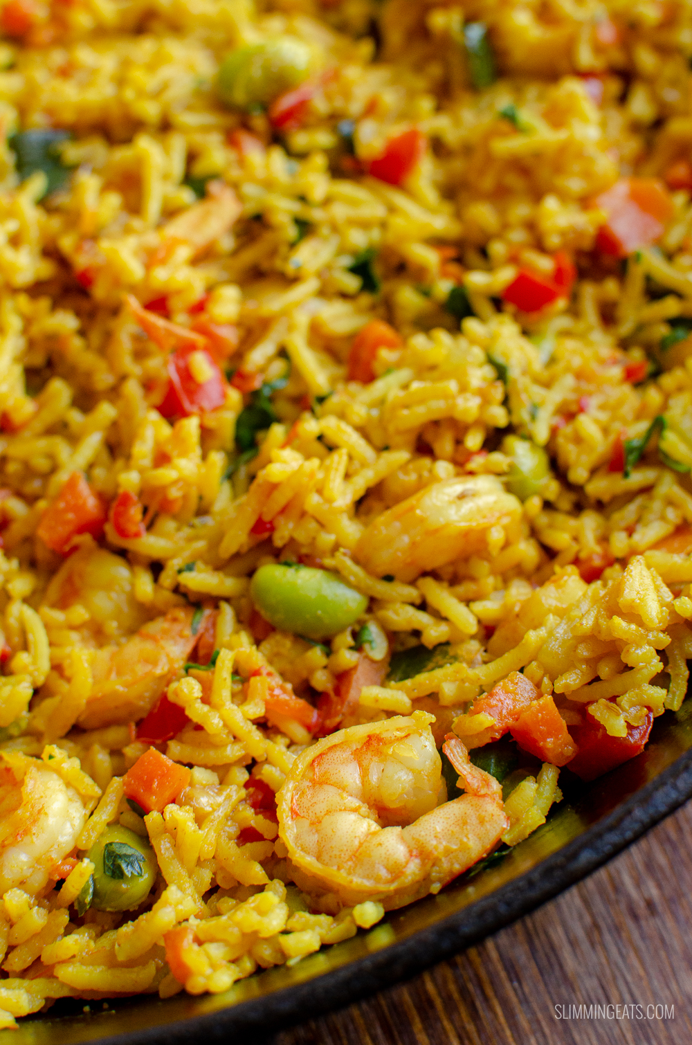 close up of prawn and vegetable pilaf in skillet