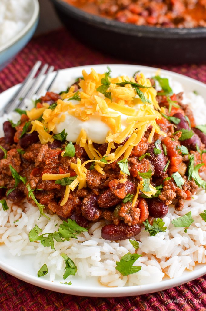 close up of Chilli Con Carne in bowl over white rice.