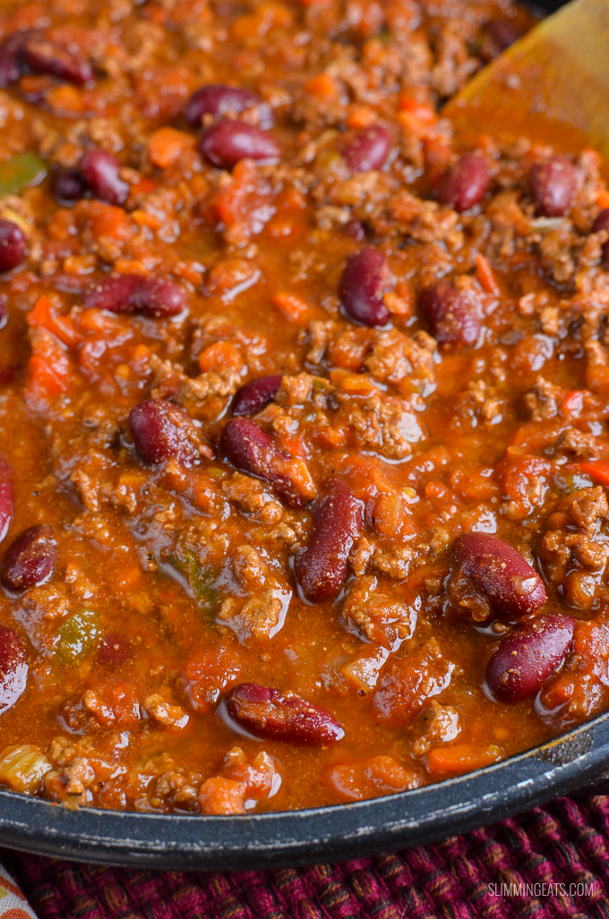 Chilli Con Carne in black pan with wooden spoon