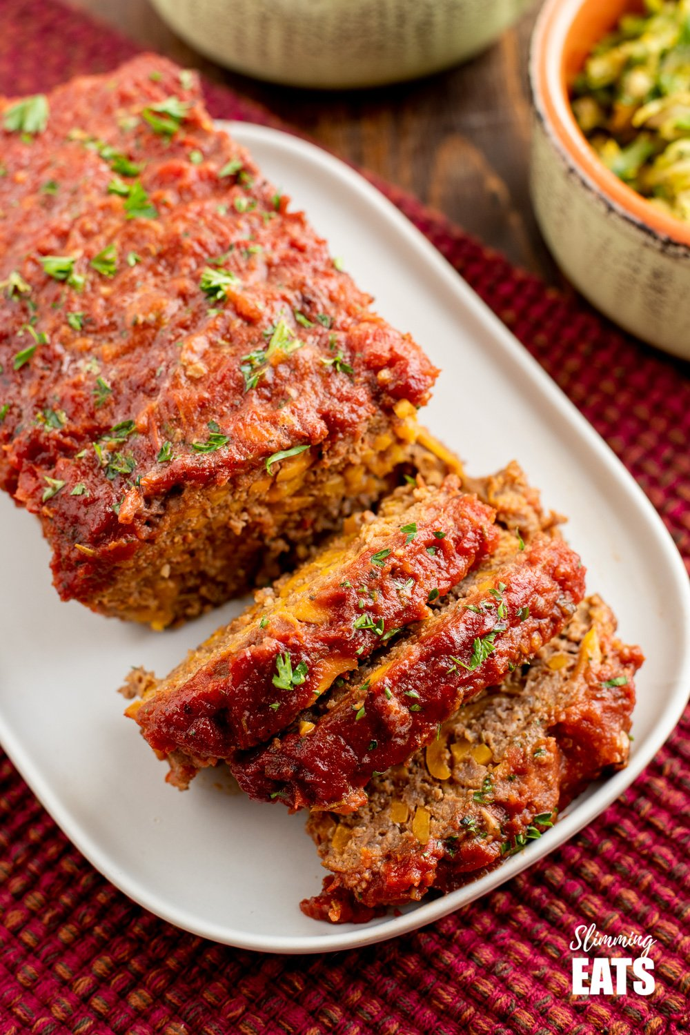 sliced beef and sweet potato meatloaf on a white plate
