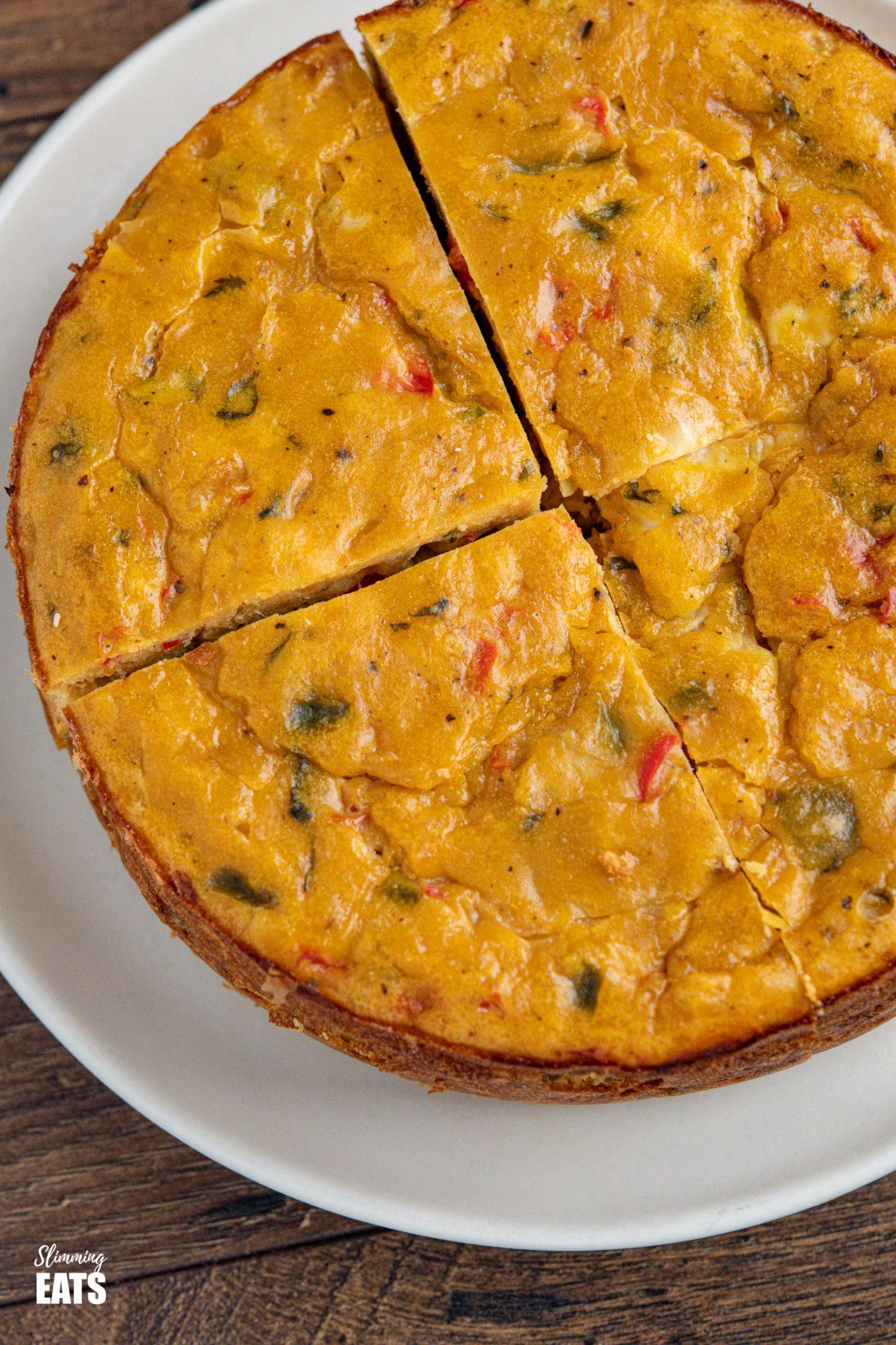 close up of sliced lentil cheddar bake on plate