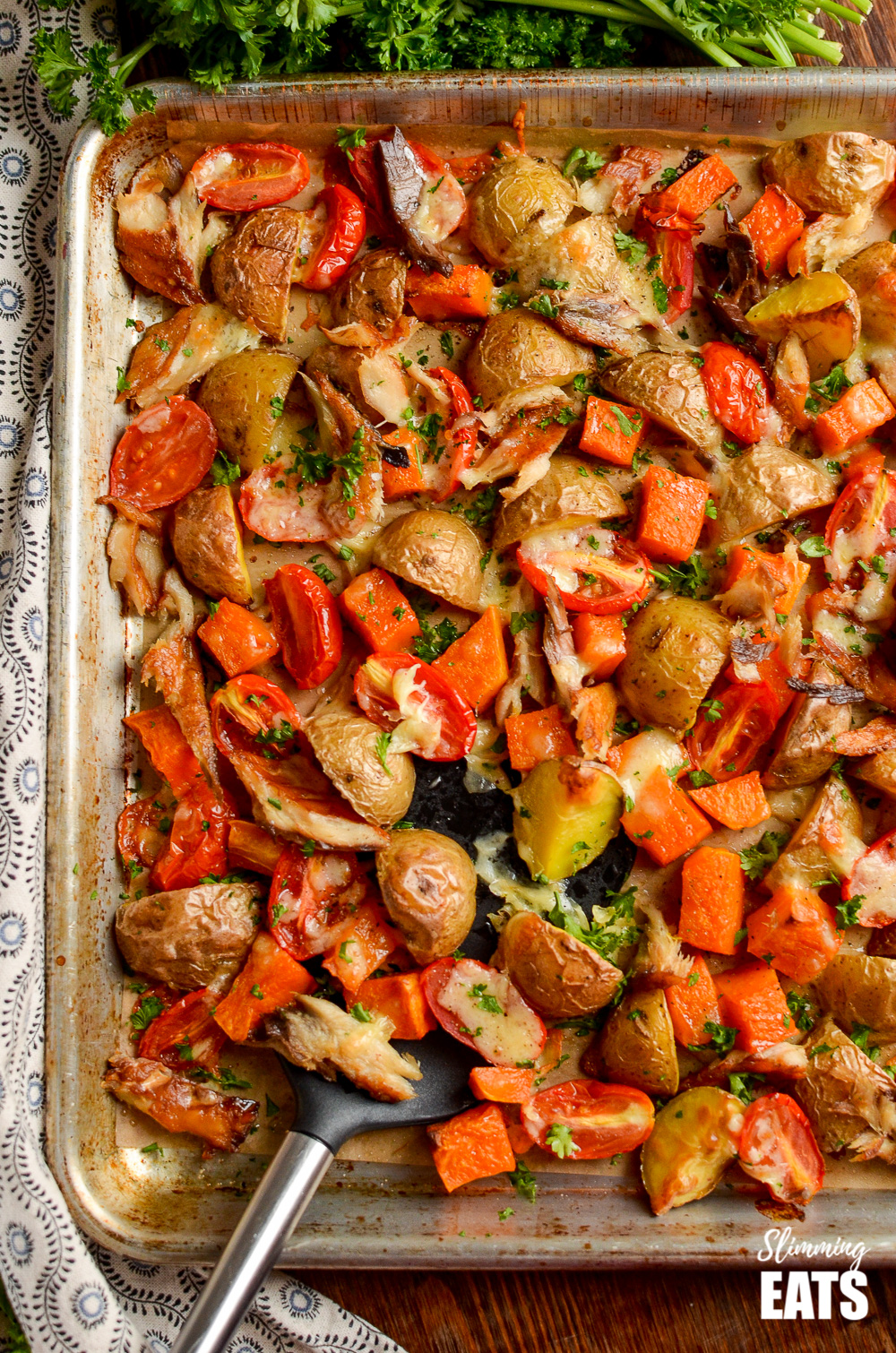 over the top view of smoked mackerel bake on a baking tray with spatula