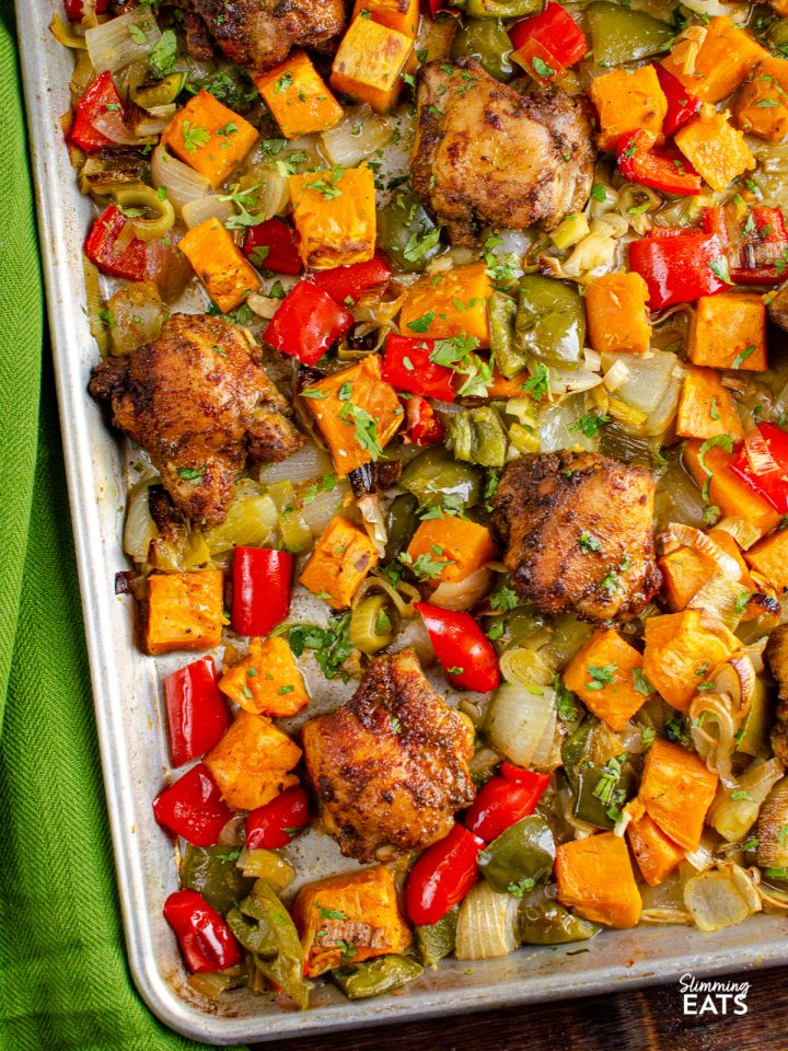 Seasoned Chicken and Roasted Sweet Potato and vegetables baked on a Tray