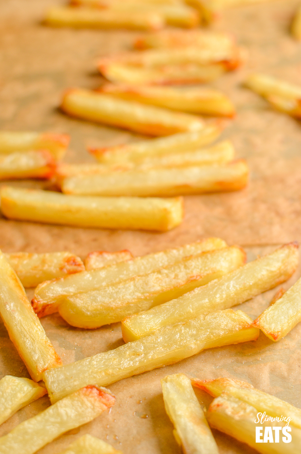 close up of perfect baked oven fries on baking tray