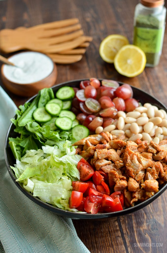 tuscan chicken salad, chopped in black bowl