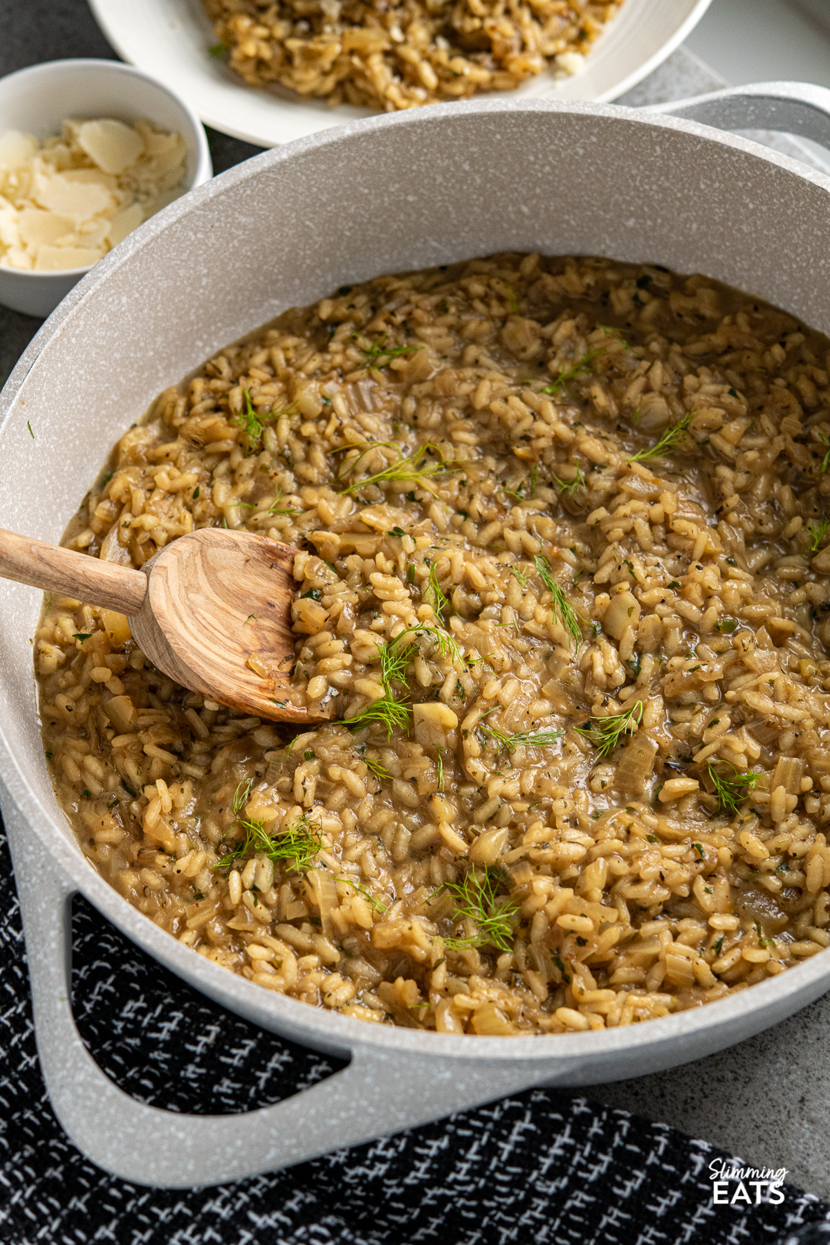 Fennel and Sweet Onion Risotto in non stick grey brown frying pan with olive wood spoon